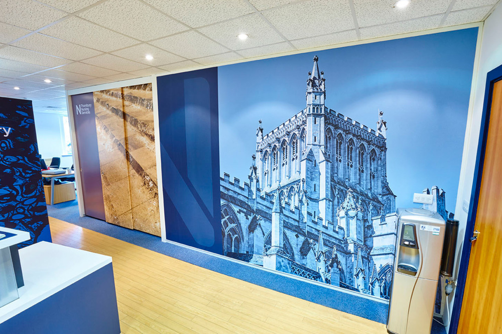 RECEPTION AFTER  We used door graphics on storage walls and bespoke seamless wall murals of local landmarks and incorporated elements from the company's recent rebrand.