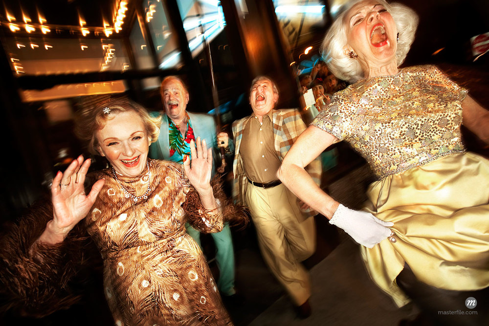 Senior Couples Dancing in Club Wearing Fancy Dress Clothes © Brian Kulmann / Masterfile