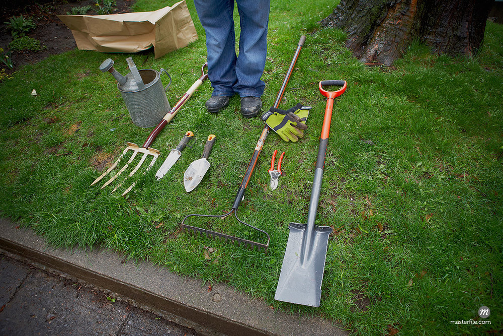 Gardening Tools on Grass in Ontario, Canada  ©  Shannon Ross / Masterfile