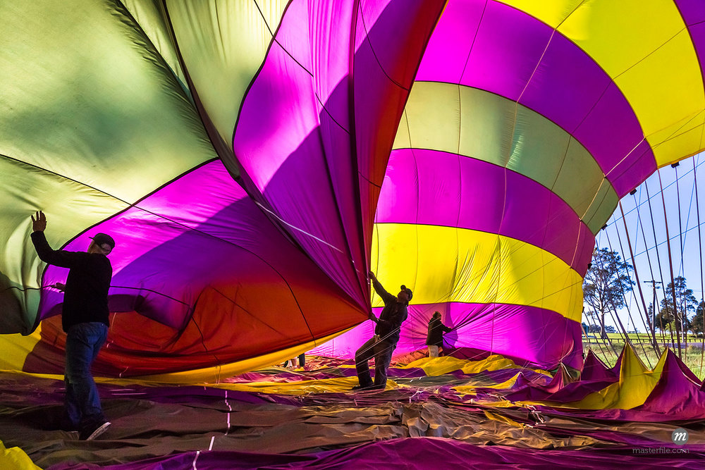 Deflating a hot air balloon near Pokolbin, Hunter Valley, New South Wales, Australia  ©  R. Ian Lloyd / Masterfile