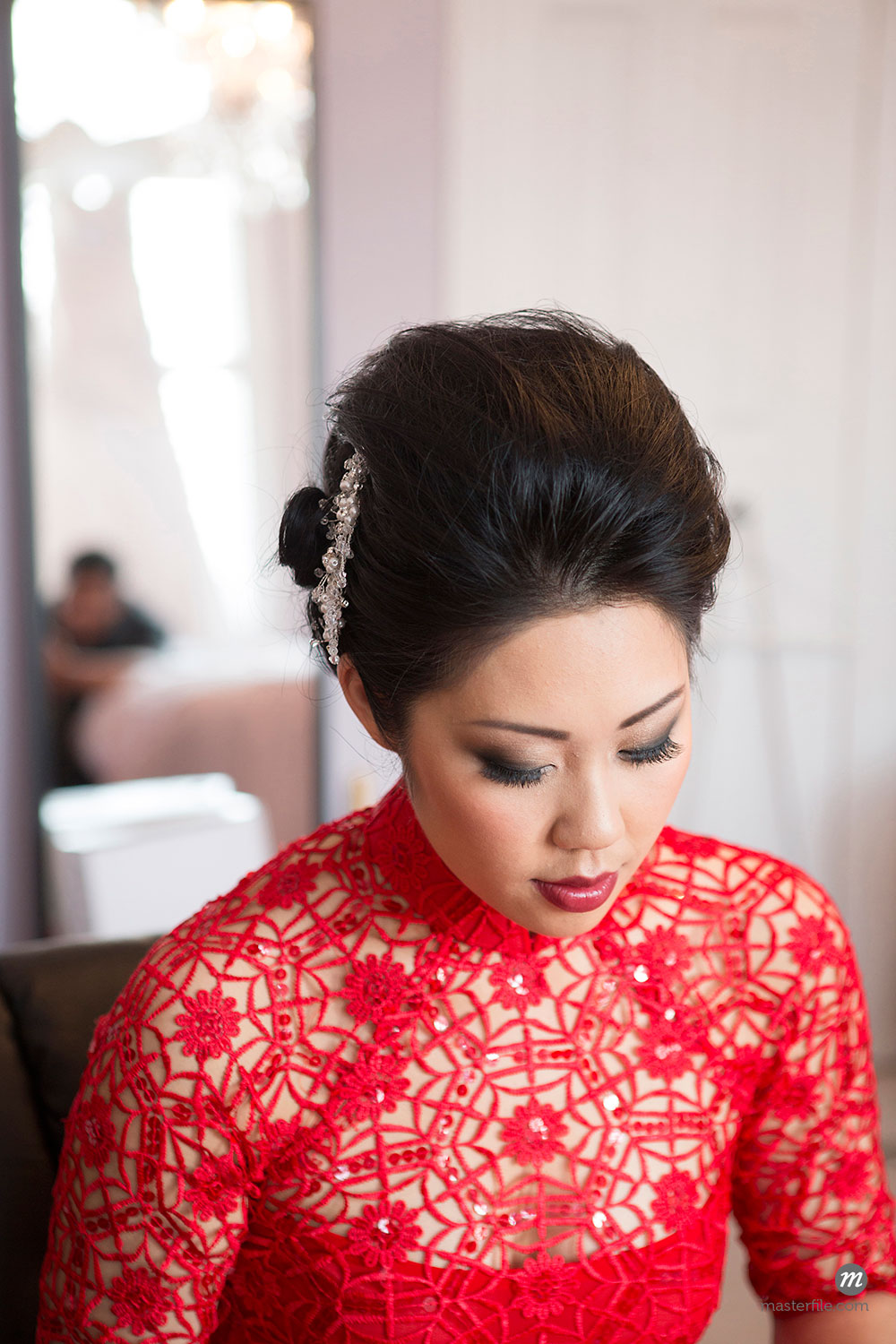 Portrait of Bride Getting Ready for Wedding  ©  Ikonica / Masterfile