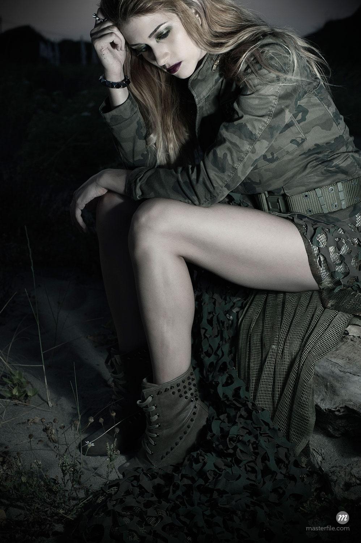 Woman wearing Camouflage Jacket  © Siephoto / Masterfile