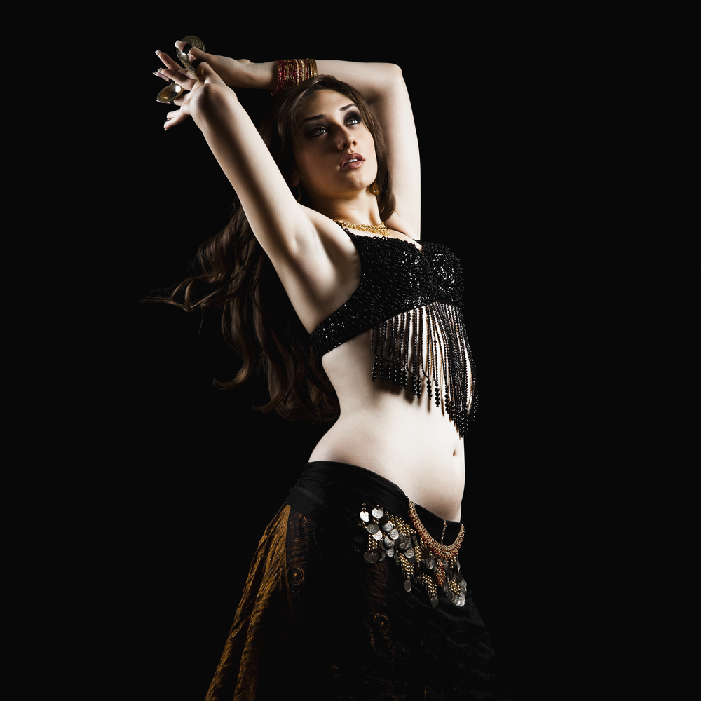 Mixed race woman belly dancing © Masterfile