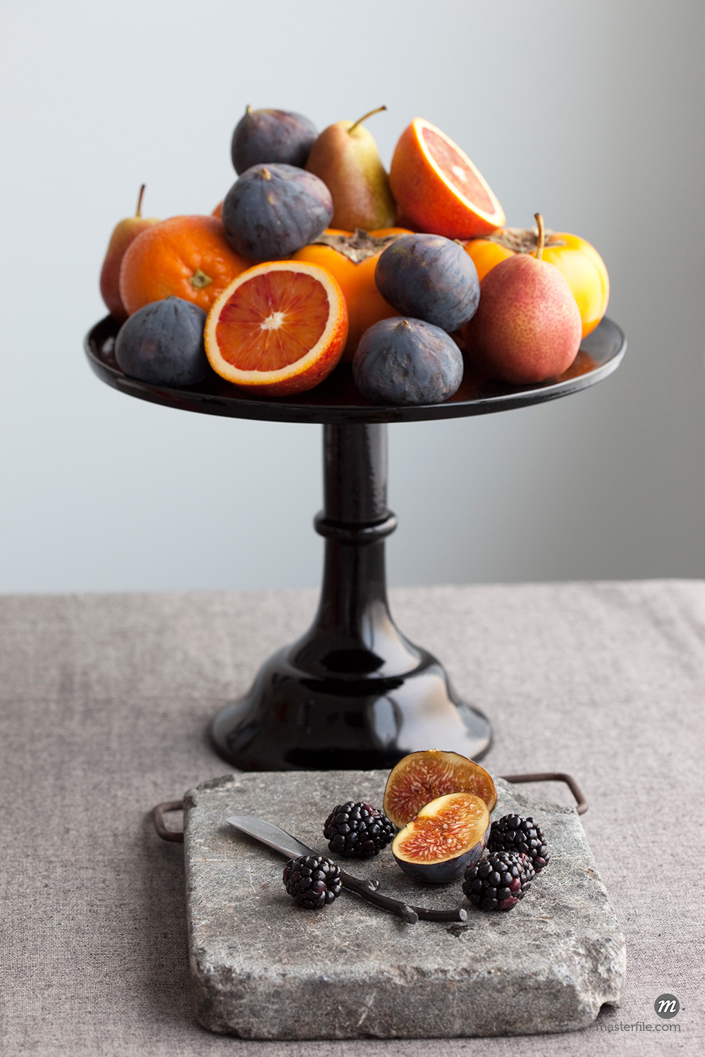 Fruit on Cake Stand and Cutting Stone © Susan Findlay / Masterfile