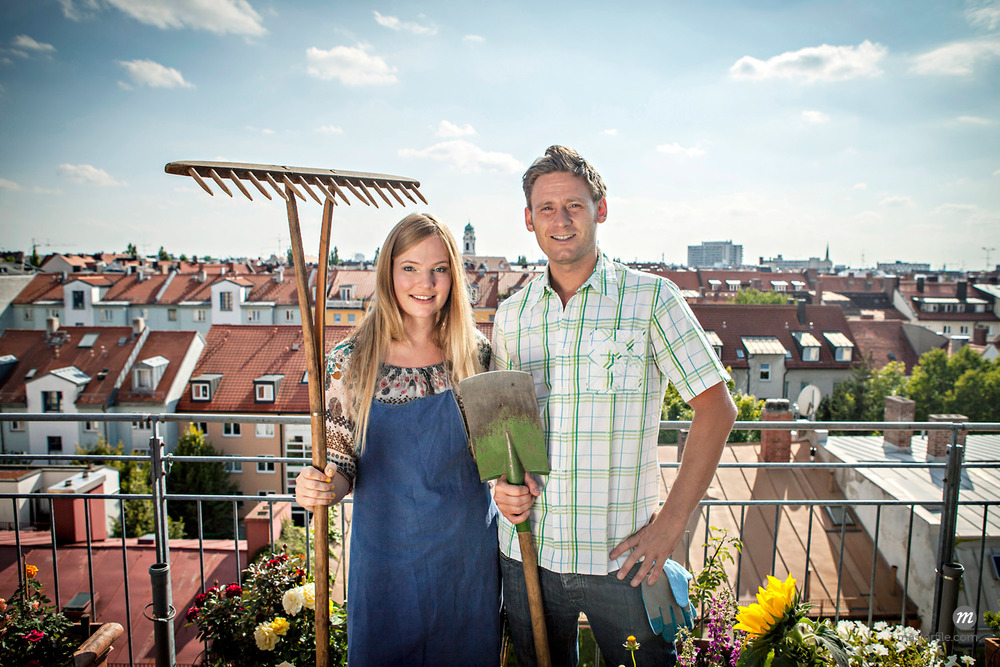 Couple on Rooftop with Gardening Tools © Masterfile Royalty-Free