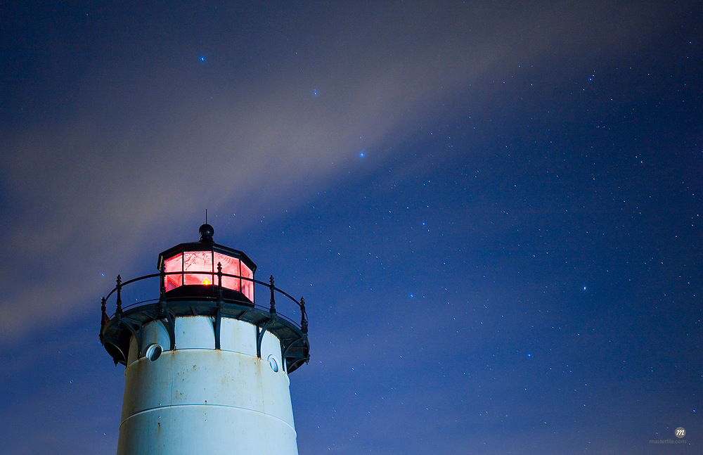 Top of the Edgartown Lighthouse in Edgartown, illuminated at night with star constellations and the 'Big Dipper' in the northern sky, Massachusetts, USA © Michael Eudenbach / Masterfile