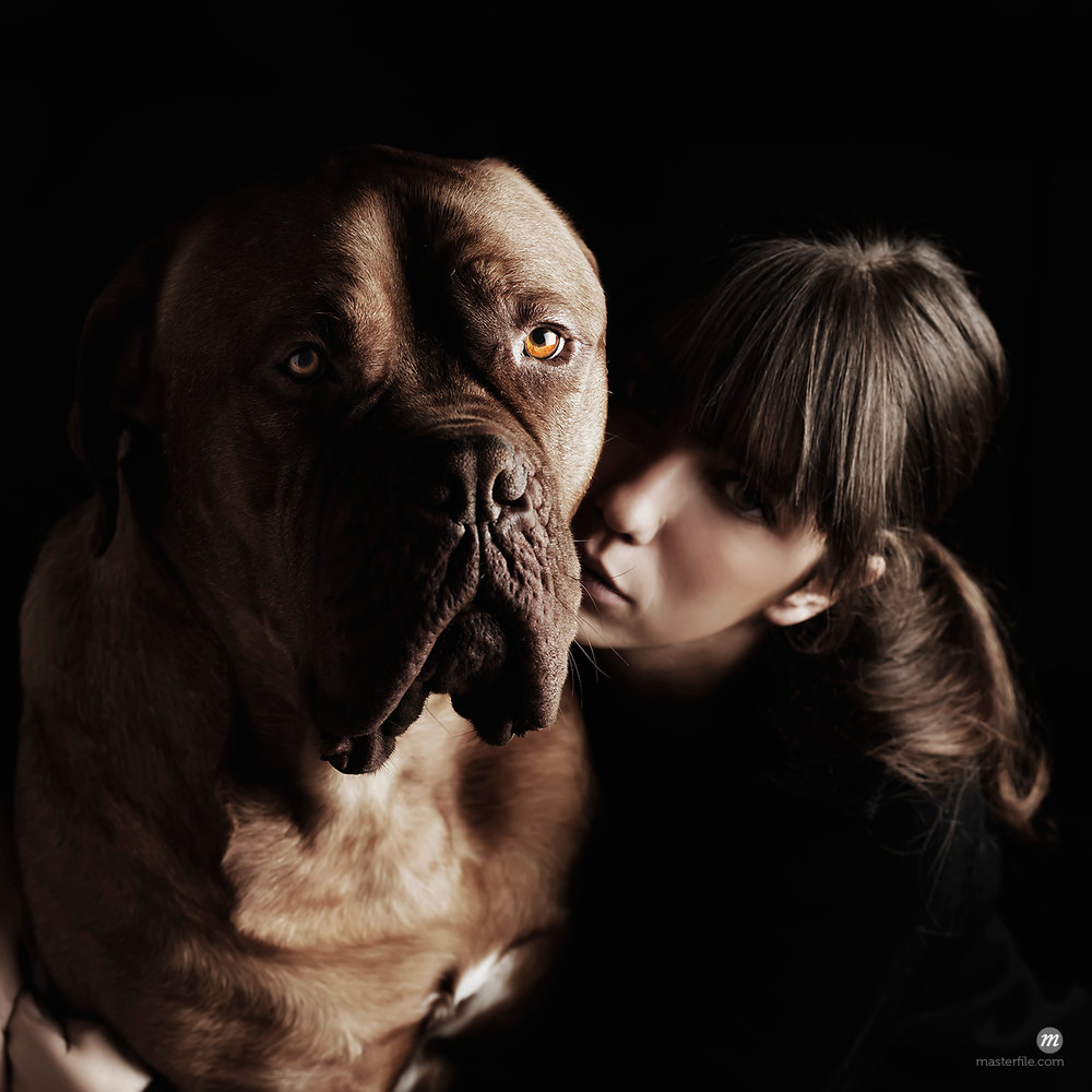 Portrait of woman and dog © Siephoto / Masterfile