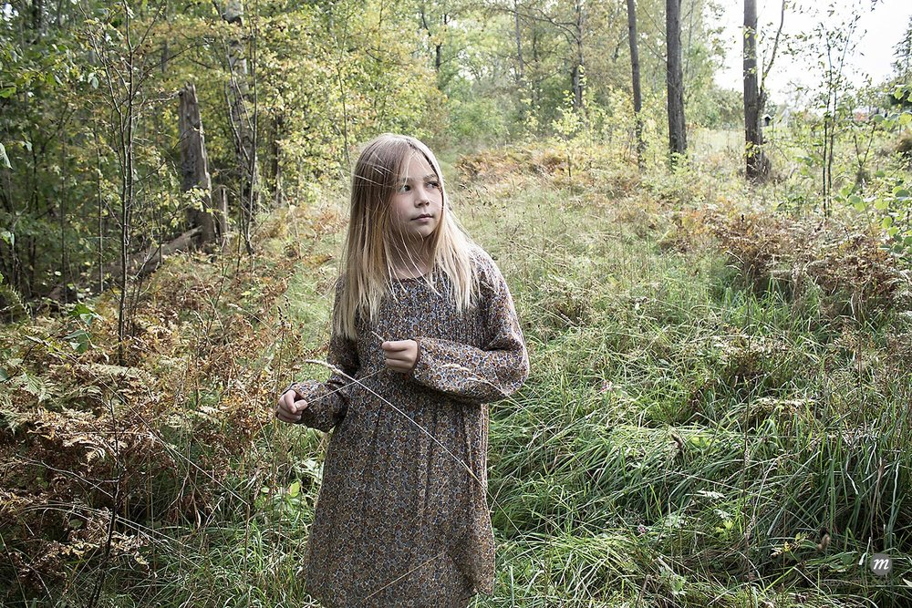 Girl with long, straight hair walking in forest, alone  © Masterfile