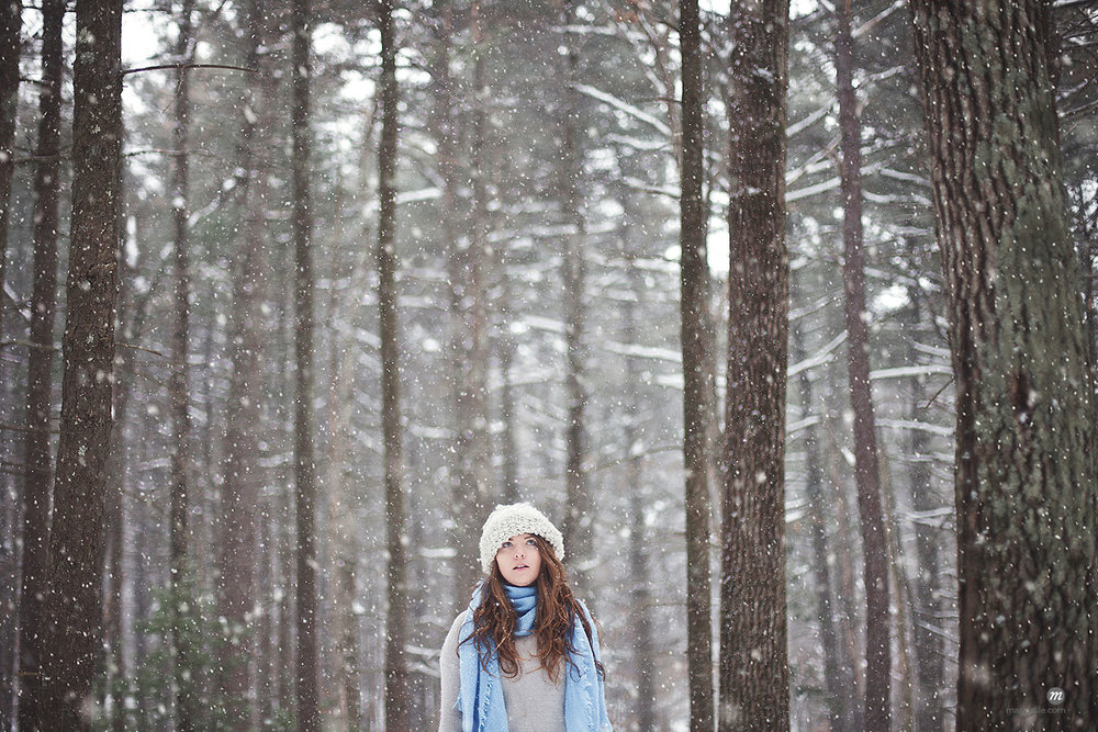 Girl standing in snowy forest  © Masterfile