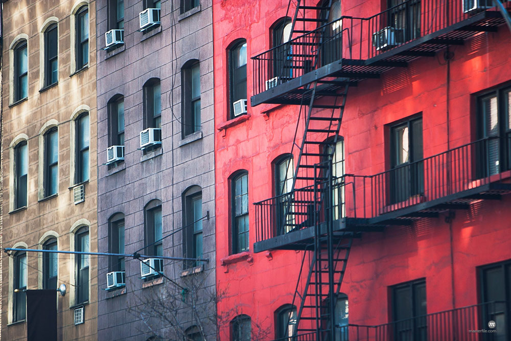 Fire escape and old apartment buildings  © Masterfile
