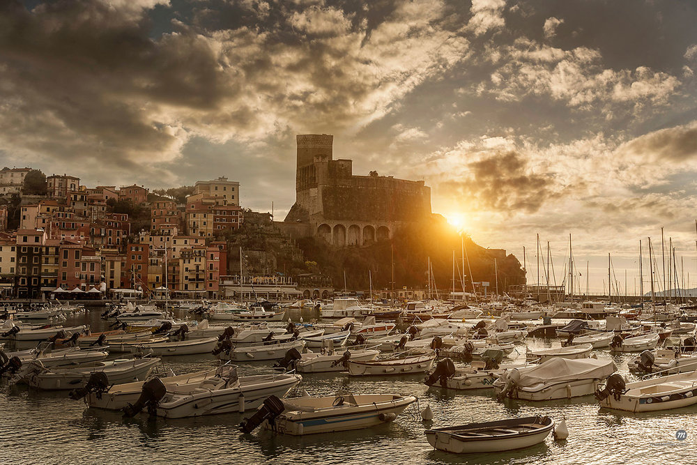 View of harbor, yachts and castle during sunset in Lerici, Leguria, Italy  © Masterfile