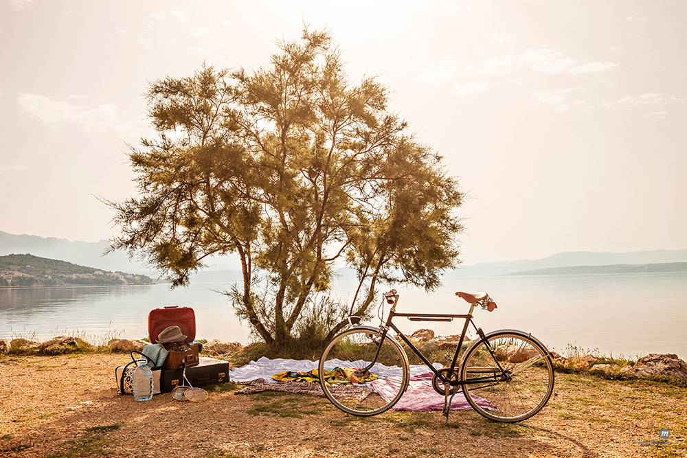 Croatia, Dalmatia, Picnic at the seaside, bike in foreground © Masterfile