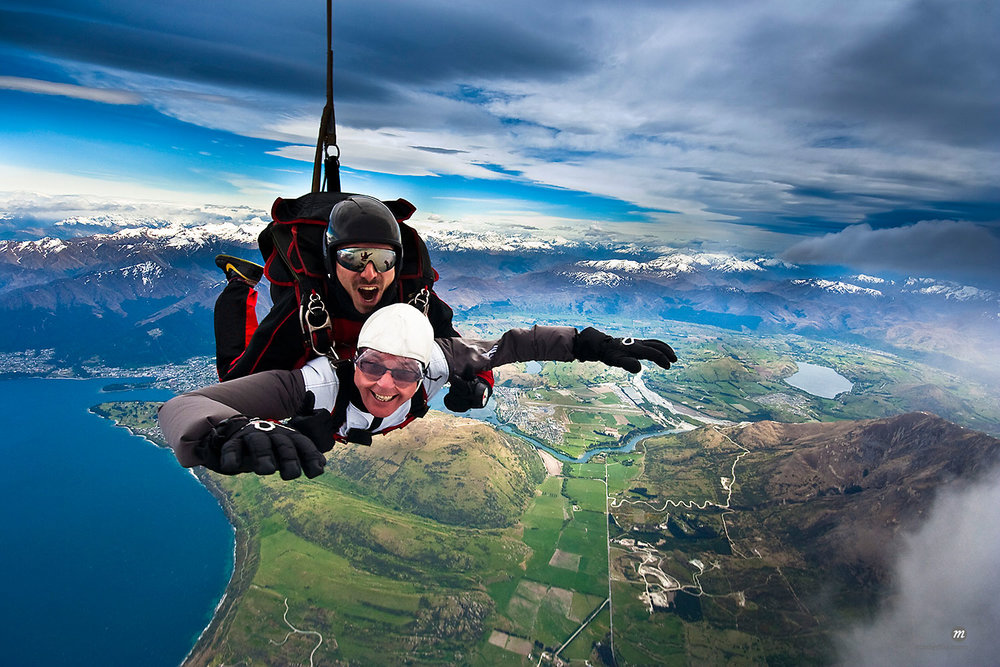 Photographer Ian Lloyd tandem sky diving over The Remarkables in Queenstown, South Island, New Zealand  © R. Ian Lloyd / Masterfile