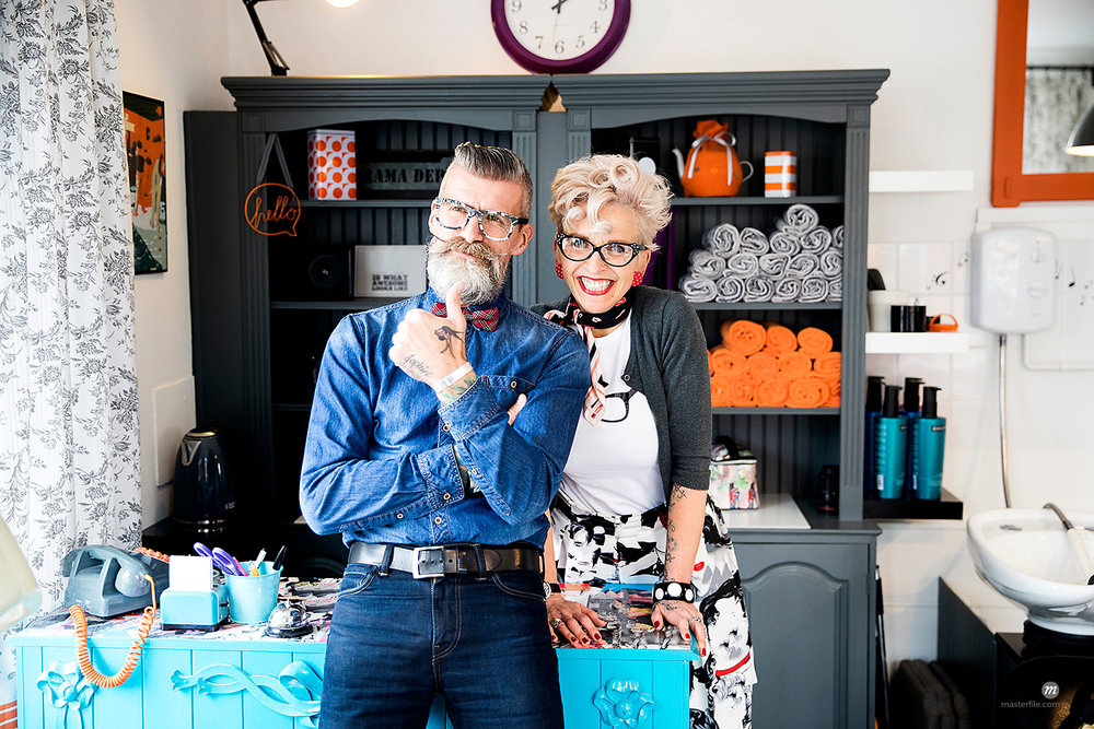 Couple in vintage clothes in quirky hair salon  © Masterfile