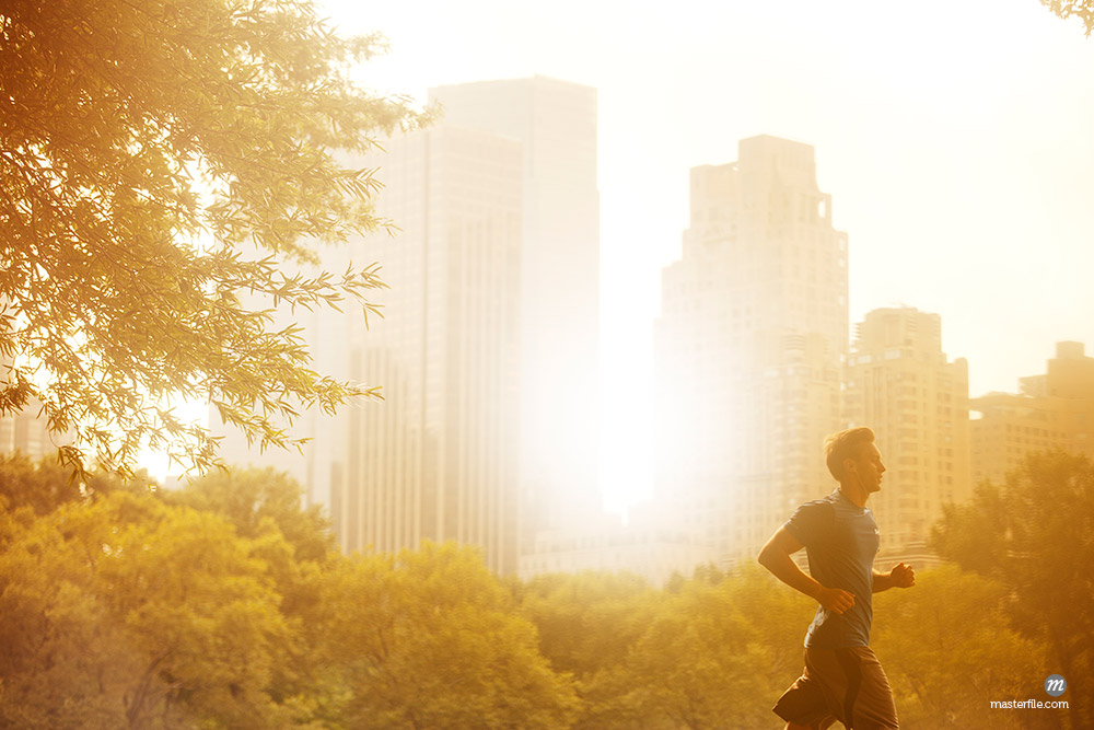 Man running in urban park © Masterfile
