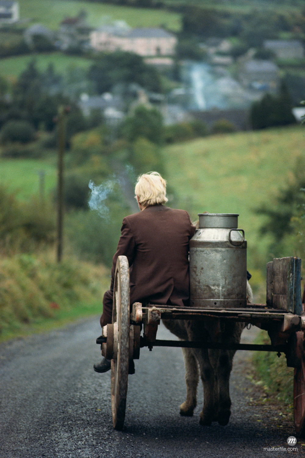 Figure riding cart with milk churn, County Leitrim © robertharding / Masterfile