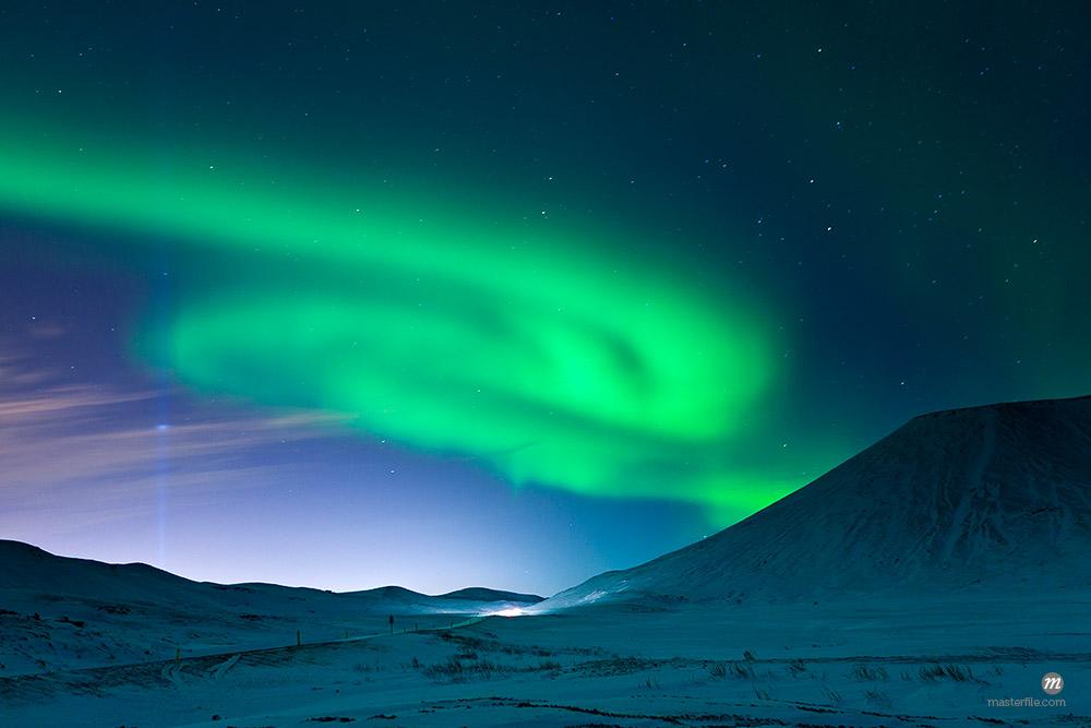 Aurora Borealis and Imagine Peace Tower, Kollafjordur Bay, Iceland © Atli Mar Hafsteinsson / Masterfile