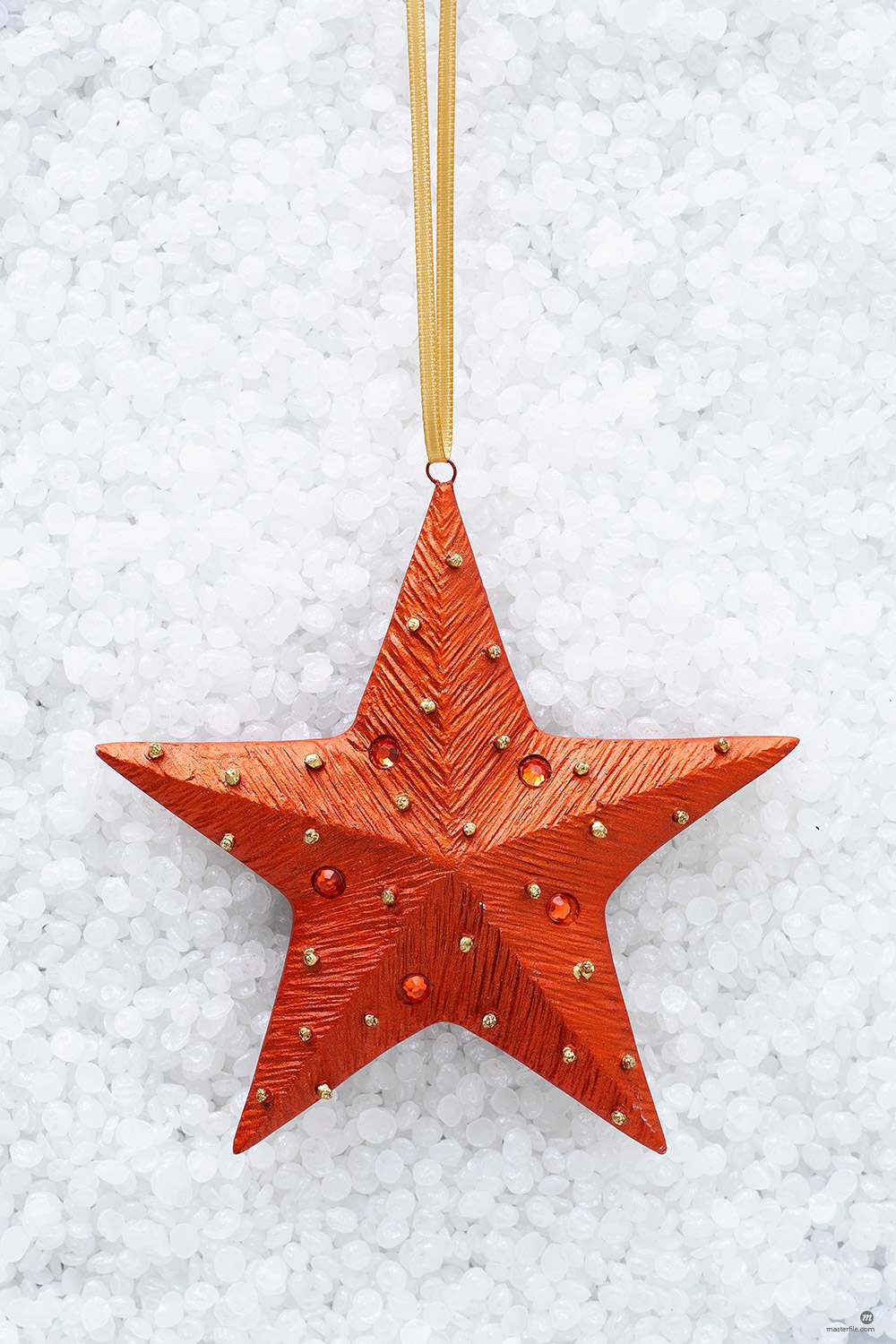 Red star shaped christmas decoration © Masterfile