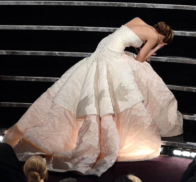 Frock Horror: Jennifer Lawrence trips up at the  Oscars  as she climbs the stairs to collect her  Best Actress  Academy Award for  Silver Linings Playbook .