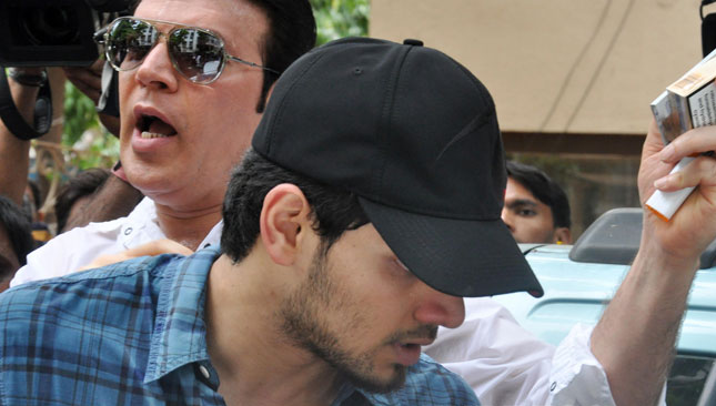 Protective father: Aditya with son Suraj Pancholi