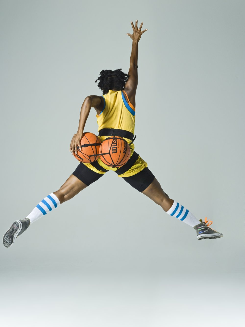 "Holly Bass, NWBA, archival pigment print, 2012. The NWBA photographic series draws on the imagery of Nike ads, poster art, the Golden State Warriors, the WNBA and ""old school"" music videos."