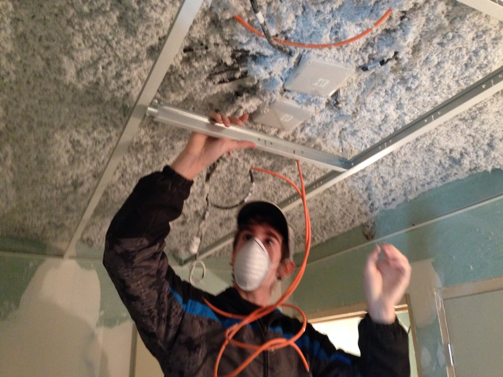 Elijah installing drop ceiling grid work