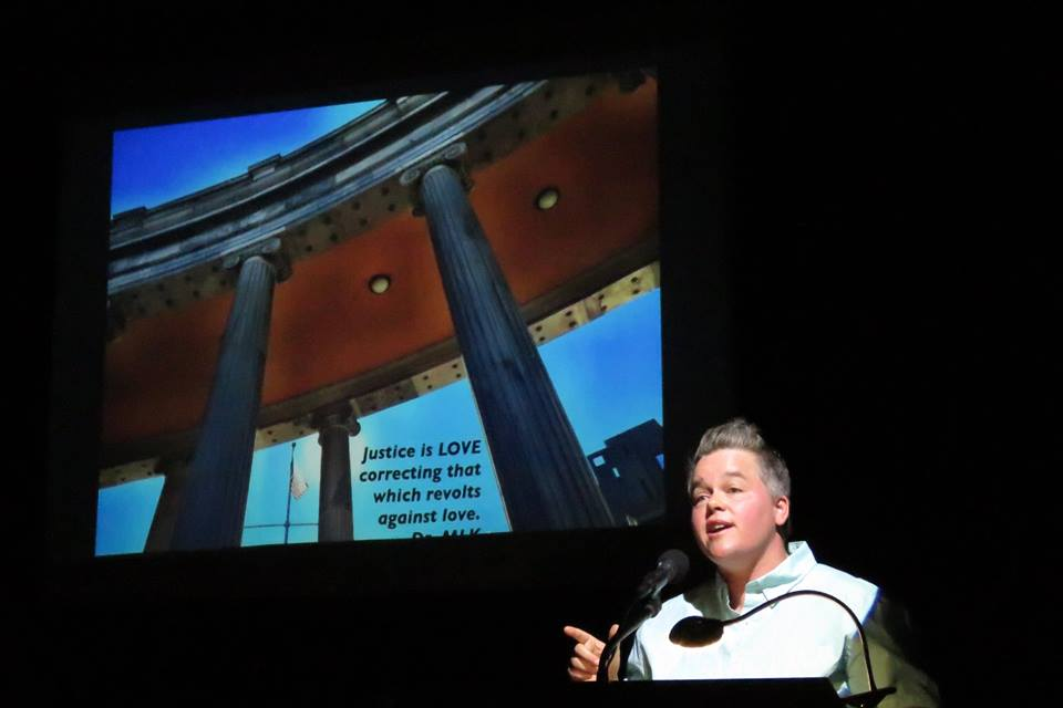 Sage speaking at PechaKucha, Maine
