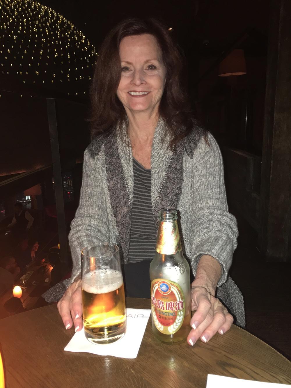 Pat enjoying her China beer