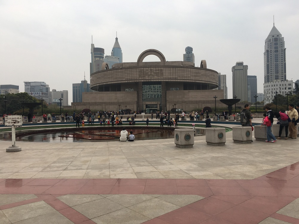 People's Square with the Shanghai Museum in the background.