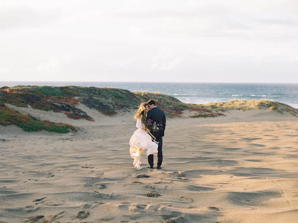 Ingredients for this elopement : crazy love, coastal breeze, and a windswept bouquet.  Photo by Brumley & Wells.