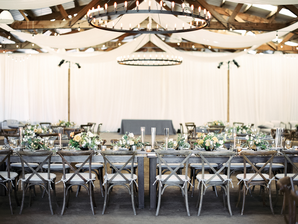 The head banquet table at this summer barn wedding in Marin County.  Photo by Taralynn Lawton.  Event Design by Jenny Schneider Events.