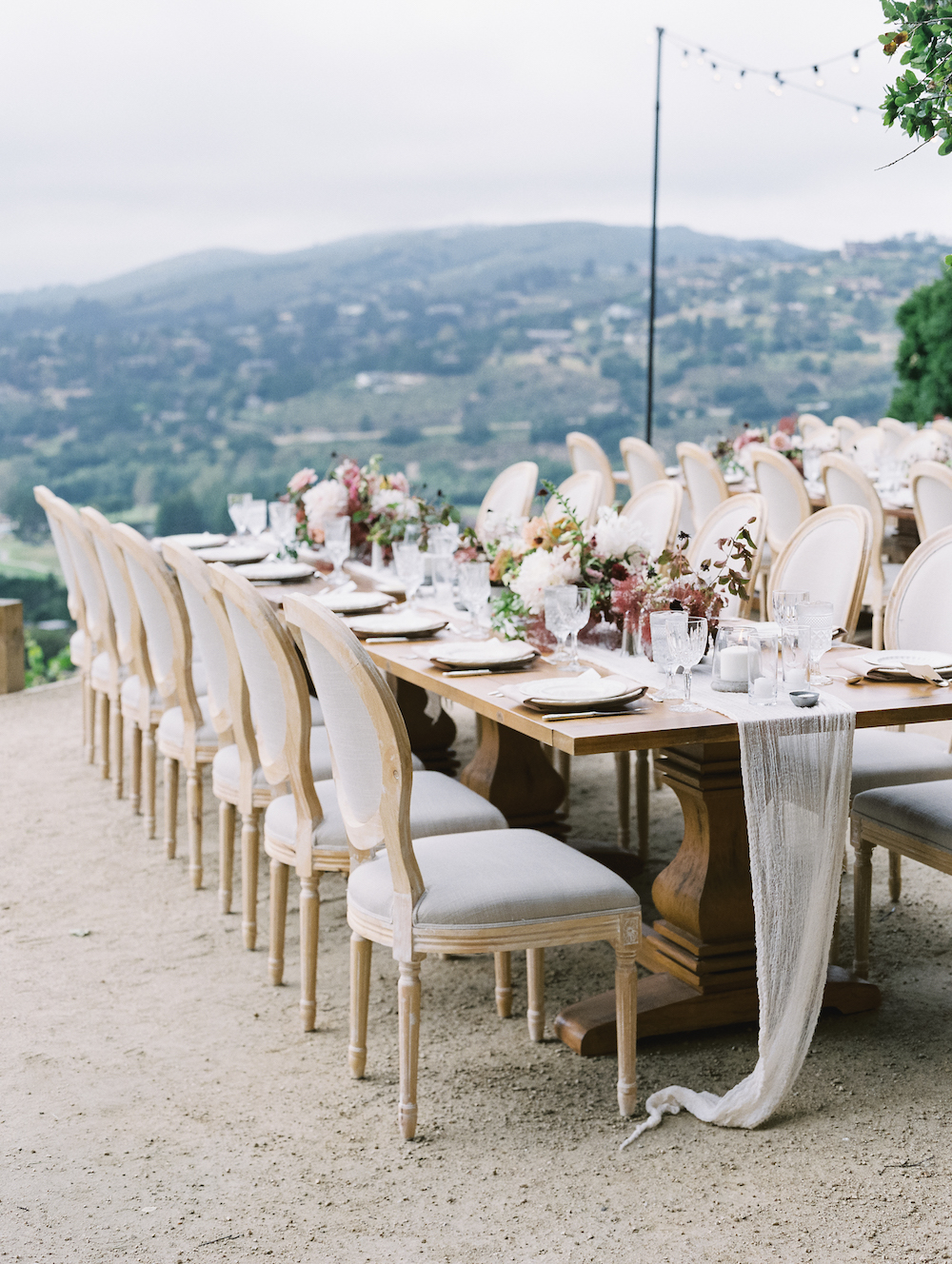 We suggested this dining configuration so each guest had a view of the valley beyond. Environment, atmosphere, and experiential design are everything.  Photo by Michele Beckwith.  Event design by Lambert Floral Studio.