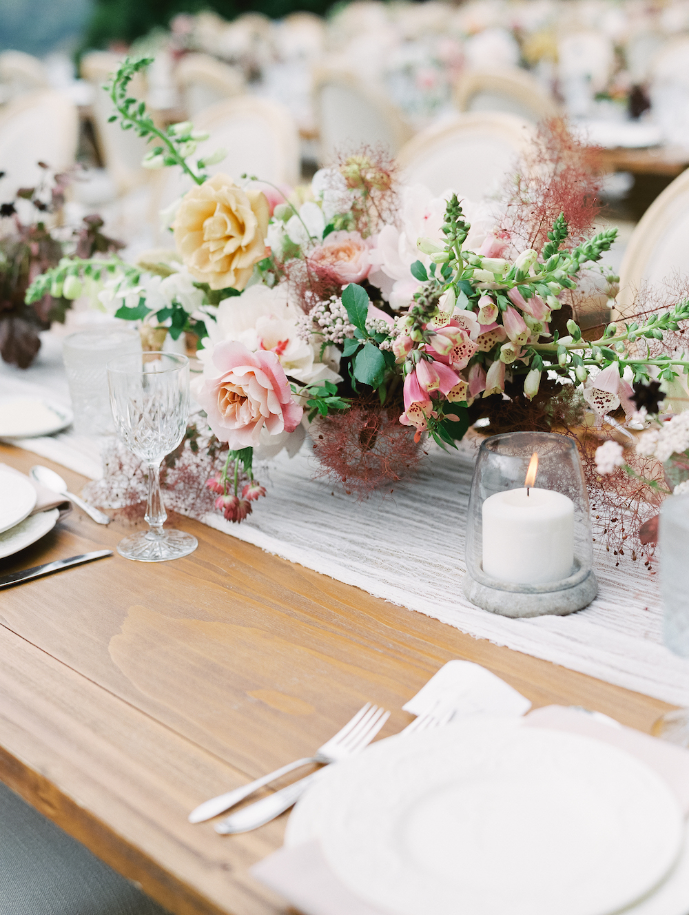 A guest's point-of-view of the tablescape; how lovely to frame conversation and courses with candlelight and a compote of midsummer blooms.   Photo by Michele Beckwith.