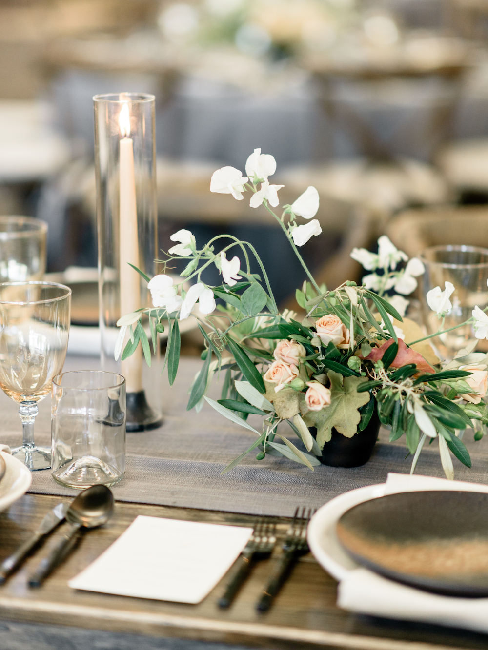 A sleek tabletop calls for finessed flowers with gestural and lyrical movement.  Photo by Taralynn Lawton.  Event Design by Jenny Schneider Events.