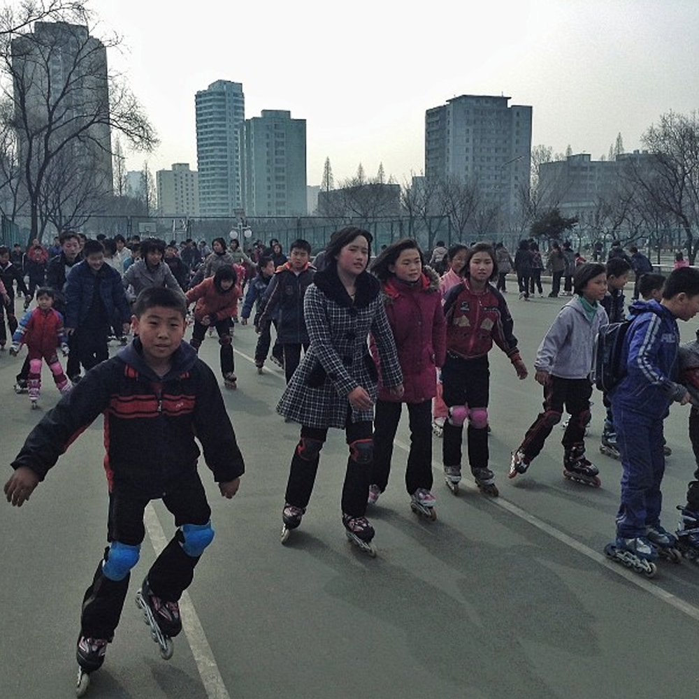 North Korean kids rollerblade at a skating track in Pyongyang. Image courtesy of David Guttenfelder.