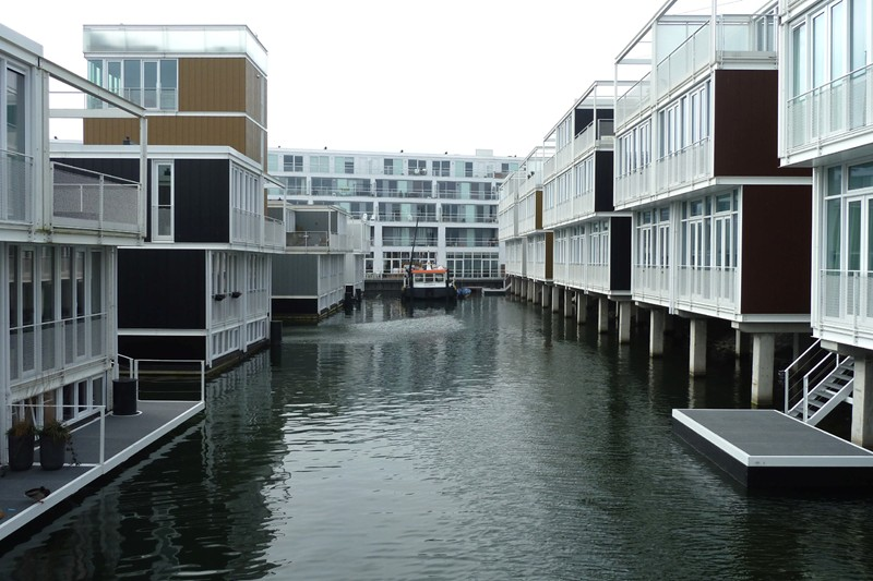 A Unique Suburb In Amsterdam, Ijberg, Sees Residents Floating And Living On  Water. Photo