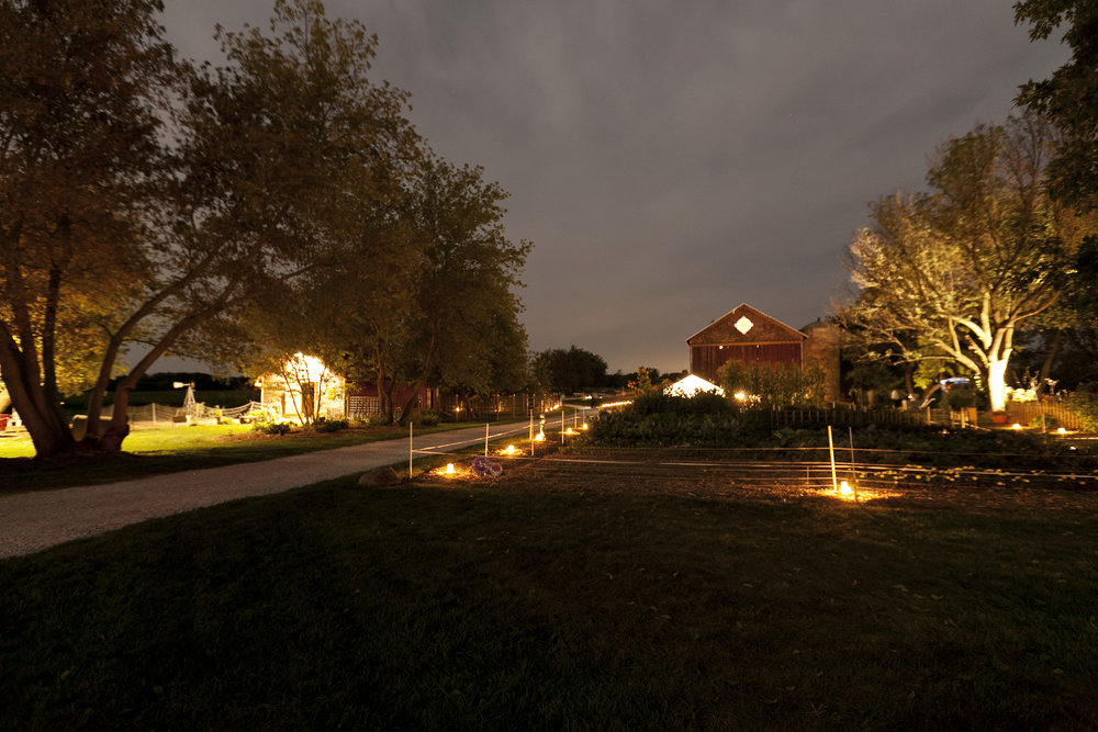 Outdoor lights guide guests down paths and illuminate the art-filled gardens.  Image by  Ellagraph Studios