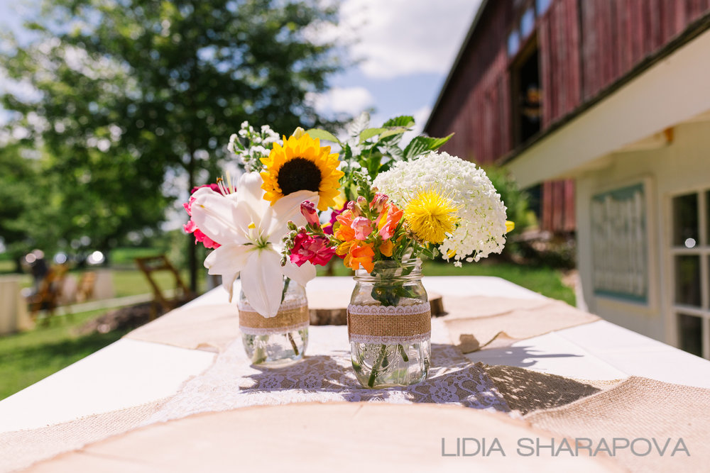 Floral arrangements complement the natural surroundings.  Image by   Lidia Sharapova