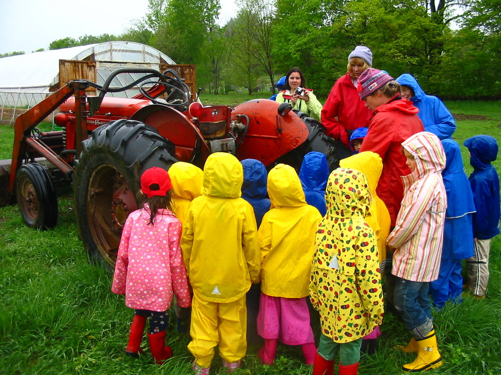Christa shows aspiring farmers from Saxon Hill School how the tractor works.