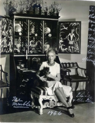 Elsie de Wolfe in front of an armoire designed for her by Tony Duquette