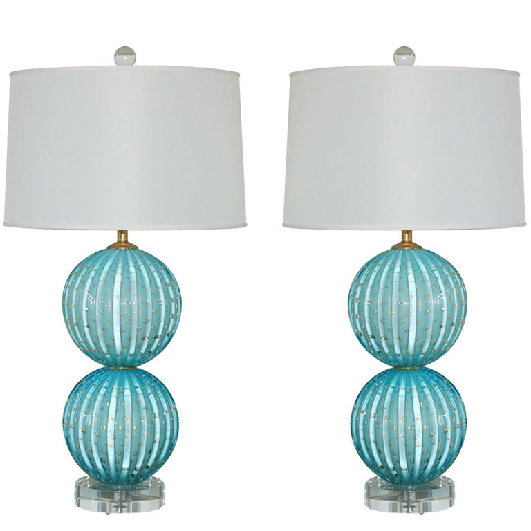 Pair of blue controlled bubble lamps with flecks of gold | via :: Swank Lighting
