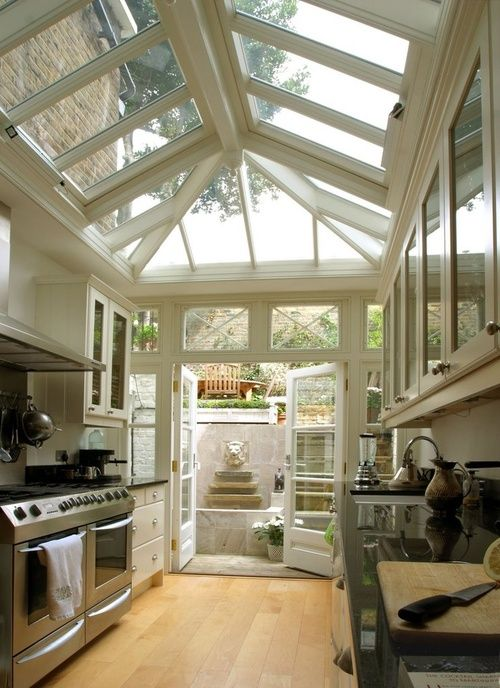 another galley with a greenhouse feel this kitchen really brings the