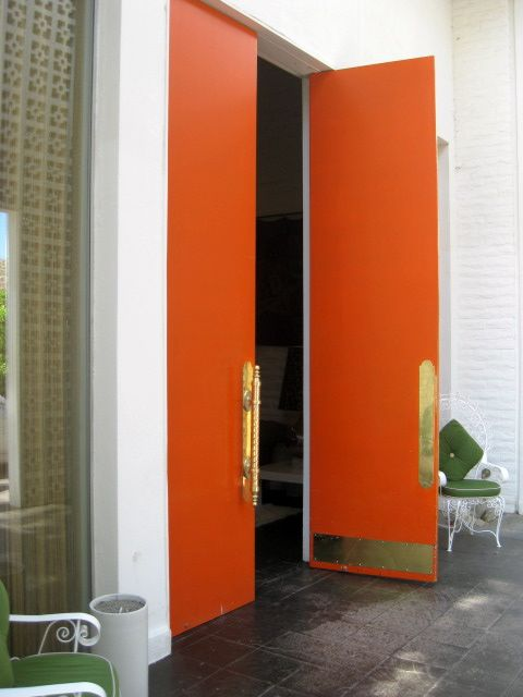 foyer-orange doors-gold hardware.jpg