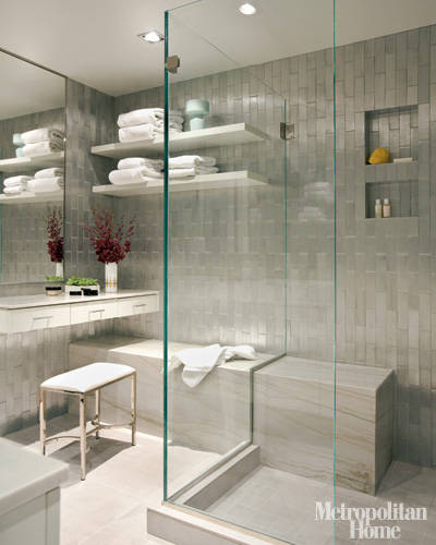 fabulous bathroom with vertical running subway tiles and built-in shower seat