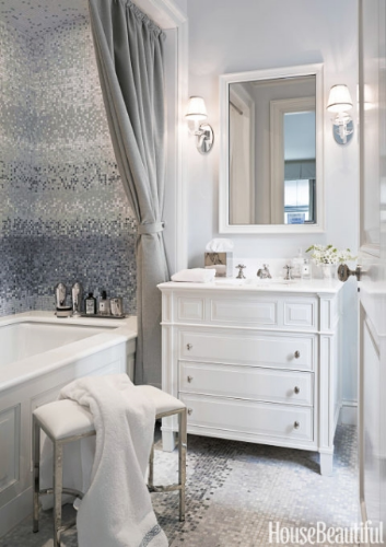 gorgeous bathroom with silver and grey mosaic tile and fabric shower curtain
