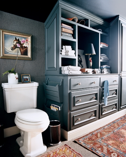blue-green bathroom with built-in storage and oriental rugs seen in domino magazine