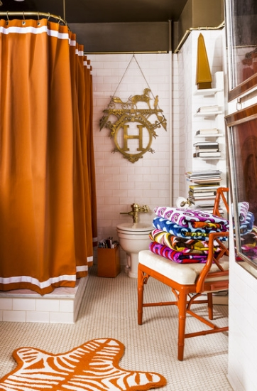 fun bathroom in orange and white with hermes medallion, chinese chippendale chair and zebra bath mat