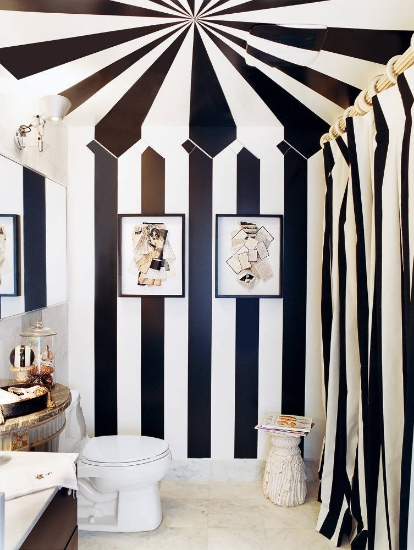 playful bathroom with trompe l'oeil painting to look like a tent with coordinating shower curtain