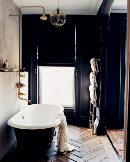 beautiful bathroom design with antique herringbone floors, dark walls and clawfoot tub