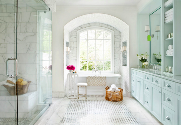 mark williams designed bathroom with marble walls and vanity with lots of storage